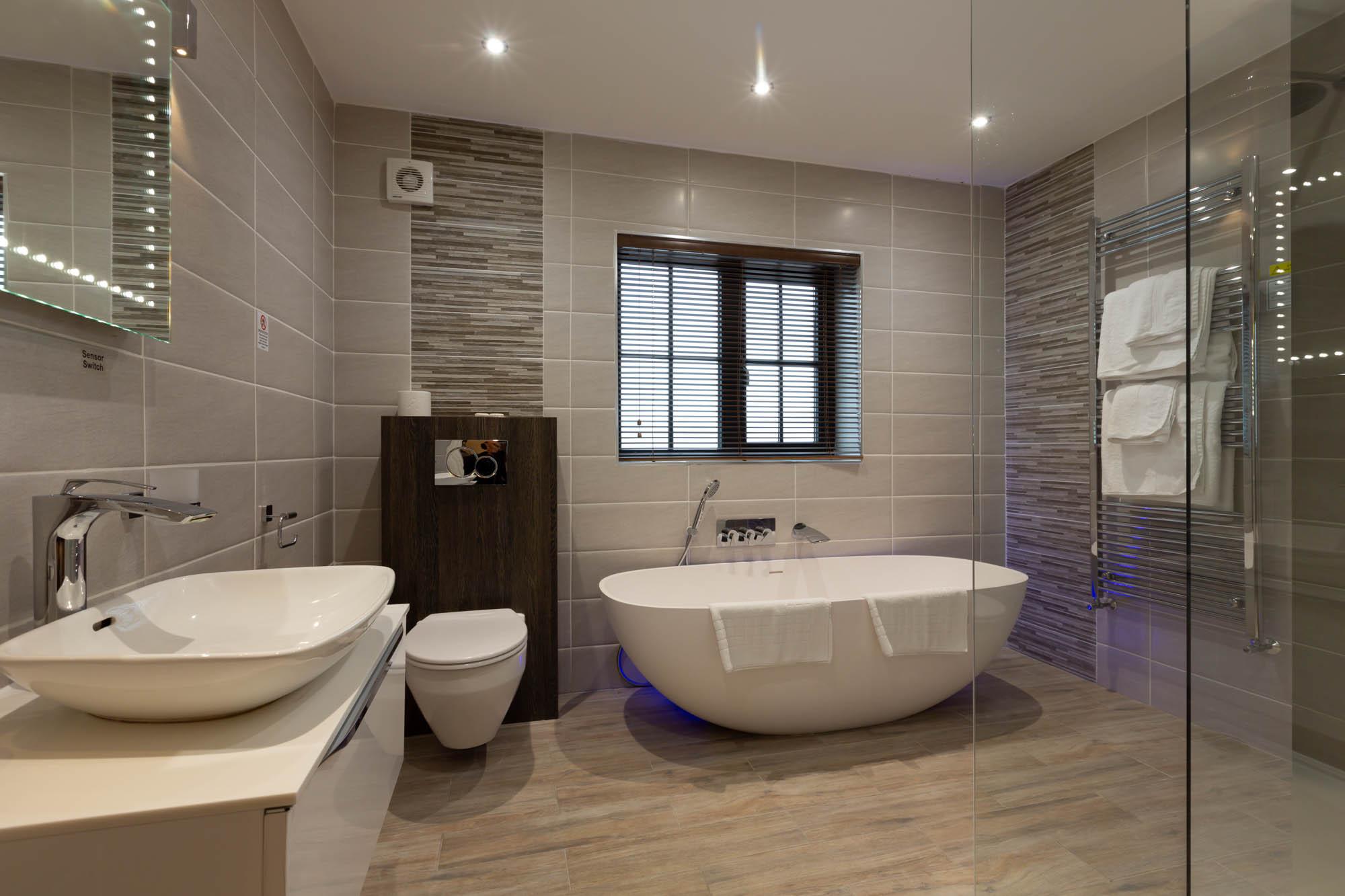 Executive Suite Bathroom with Freestanding Bath